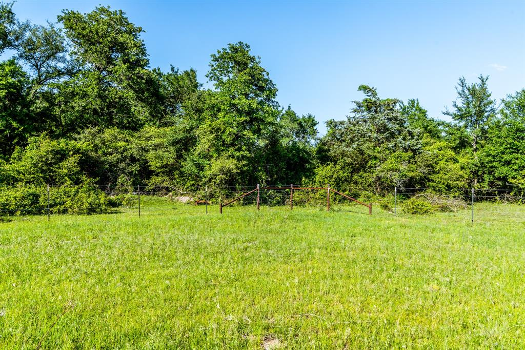 Don't sleep on this 185 acre horse/cattle ranch just minutes from Madisonville, Texas. Location, location, location! Only 1.5 hours from Houston, with proximity to the growing Bryan College Station area as well as Huntsville, Conroe, the Woodlands, Lake Livingston, etc! This property is situated to become the ranch of your dreams. Boasting sandy soils and improved pastures it is a cattleman's delight and can also make a great equestrian property, as well as hunting or recreation. Recent improvements include new fences, gates, and improved pastures. The current owner has an agricultural exemption which means low taxes for you! Do not miss out on this gem! If less acreage is to be desired, the owner is willing to subdivide and has 85 acres of this ranch listed separately as MLS ID: 66184827