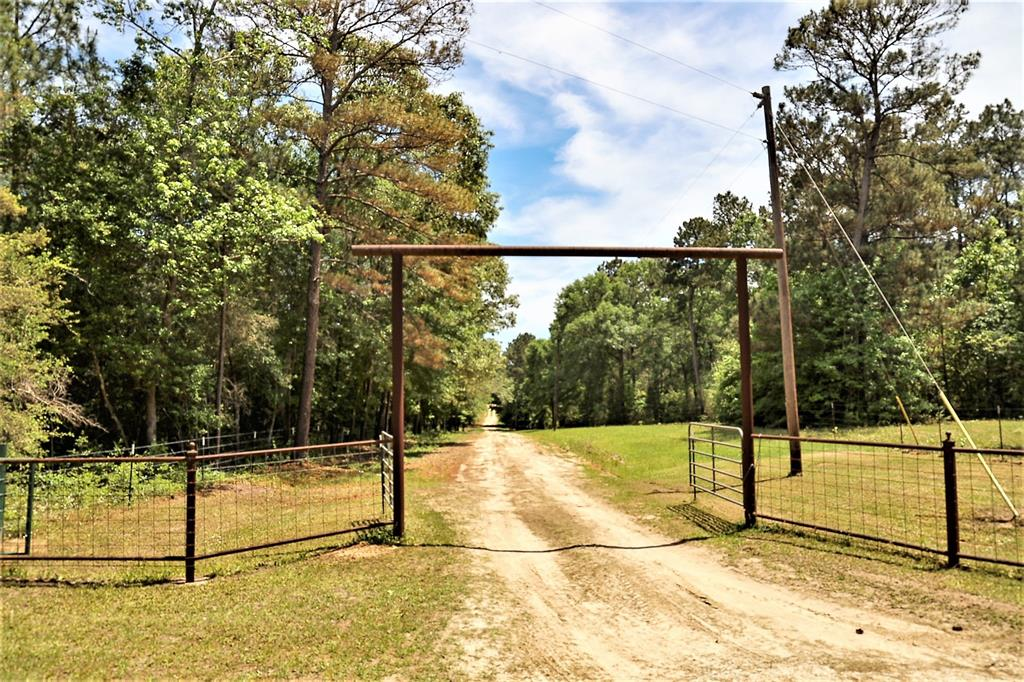 Beautiful property on 18.4 acres in the Piney Woods! Only 9 miles East of Corrigan! This property has it all, cattle ranch, pond for fishing, workshop, pasture, and is fully fenced. The 4 bedrooms, 2 baths home is in excellent condition,has stainless steel applainces and will just need some updates.The air conditioning was replaced recently. The hot tub and firepit overlooking the land make for wonderful outdoor living!  This could be a week-end home, or a permanent home.  The owners currently have about 20 heads of cattle, but the property is large enough to accommodate more.