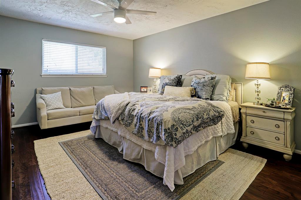 Large primary bedroom is light and bright.