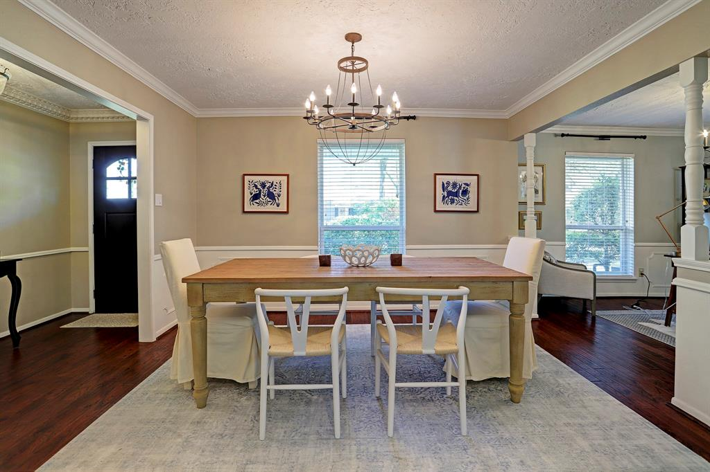 To the left when you walk in through the front door is the dining room. Perfect for a large table and open to the living room area.