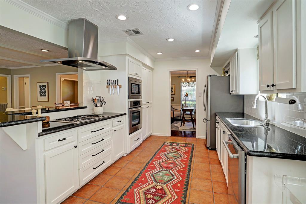 Updated kitchen with stainless steel appliances. Recessed lighting and plenty of room to cook.