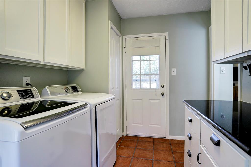 Utility room leads out to backyard. Nice countertop space for folding laundry or setting up a coffee bar.