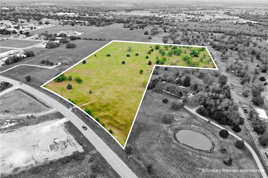 Enjoy the best of both worlds on this 14.064 AC property located less than 5 minutes from the center of Giddings while still being partially outside city limits. City utilities and sewer are available for this fully-fenced acreage, which is currently being used for cattle and has an Ag Exemption in place. The land is predominantly flat and open, with a small number of mature trees, making this land ideal for agricultural use, a large, personal homestead close to town, or even development purposes!