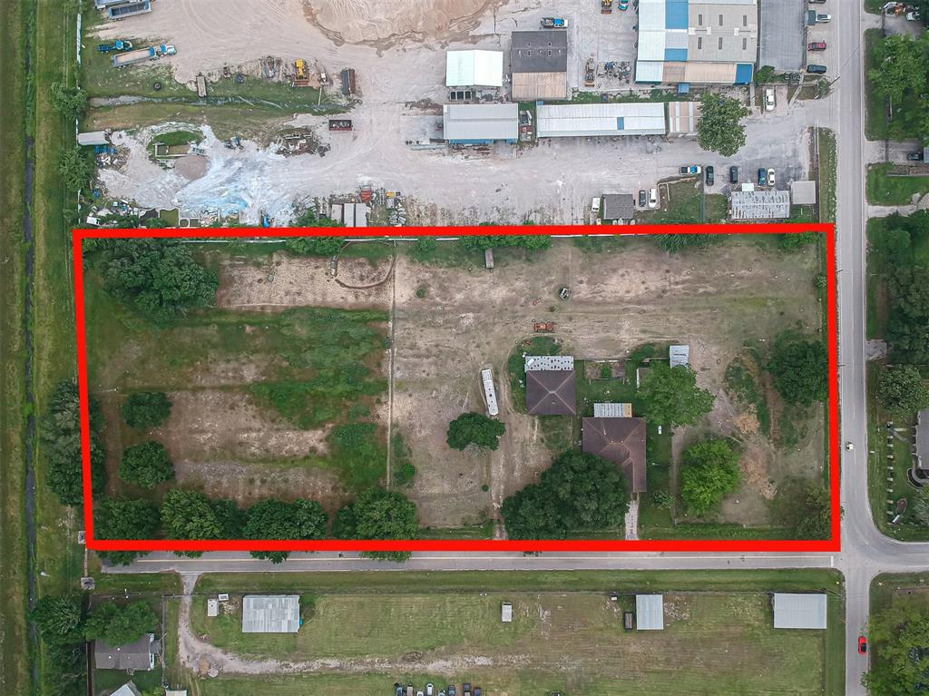 Mixed use property. This 4.2+ acre urestricted fully fenced property has easy access to Beltway 8. All utilities are established with 4 points of entry to the property. One house is fully functional 1543 sqft. built in 1967 per tax records 2/2/2. Second house is a  framed structure  , 2480 sqft. built in 1982 per tax records number of bedrooms undetermined, tax record is showing total of 5 bedrooms between two homes. Frontage on two streets. All room measurements and number of bedrooms and bathrooms are approximate. It is the Buyers responsibility to verify.