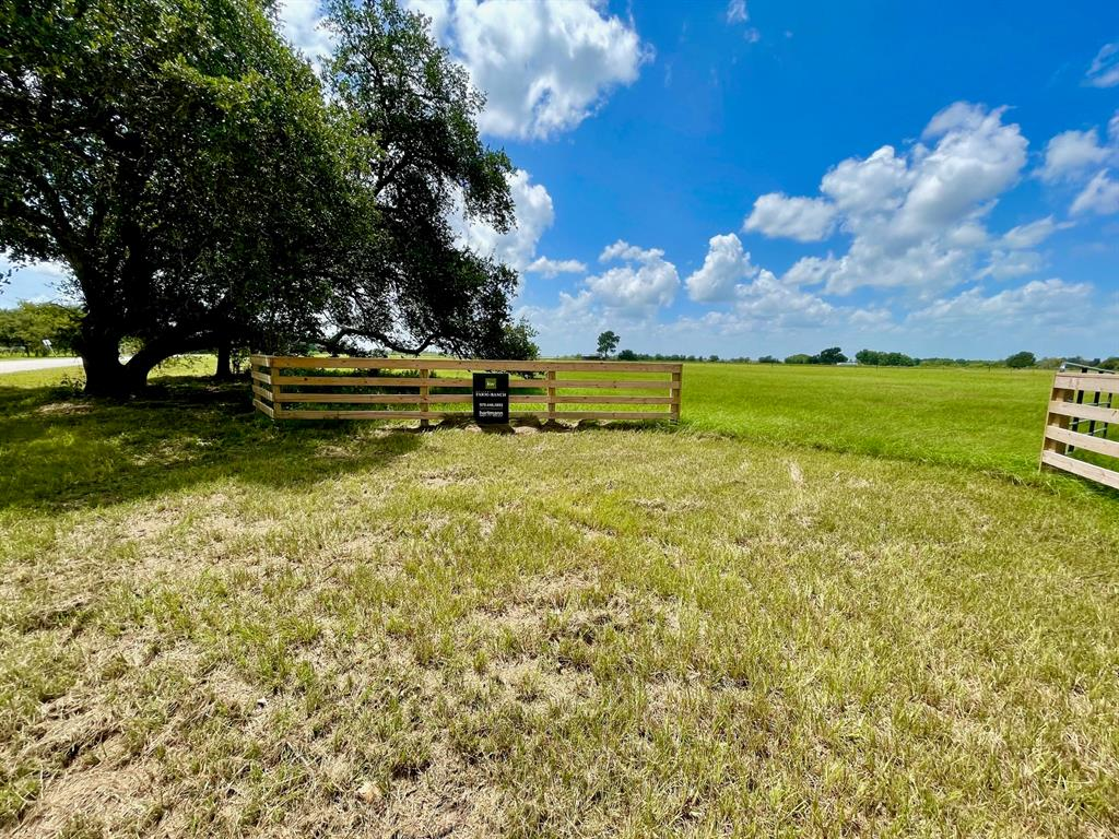 Beautiful country acreage! Hard to find 10.365 +/- lightly restricted acreage in the highly desired area of Bellville Texas. This property comes complete with newly constructed barbed fire-wire perimeter fencing, quality built 4 rail entryway with a culverted entry drive through the property gate. (this tracts entry drive scheduled for completion September 25th, entry drive photos of a neighboring tract with same build specifications) Currently, ag exempt with zero flood plain, the land is primarily open with scattered trees and improved and native grasses. Electric and water are available along the approximate 404 feet of paved county road frontage on school road with easy and quick access to the HWY 159 corridor which will quickly get you anywhere you want to be for business, living or leisure.