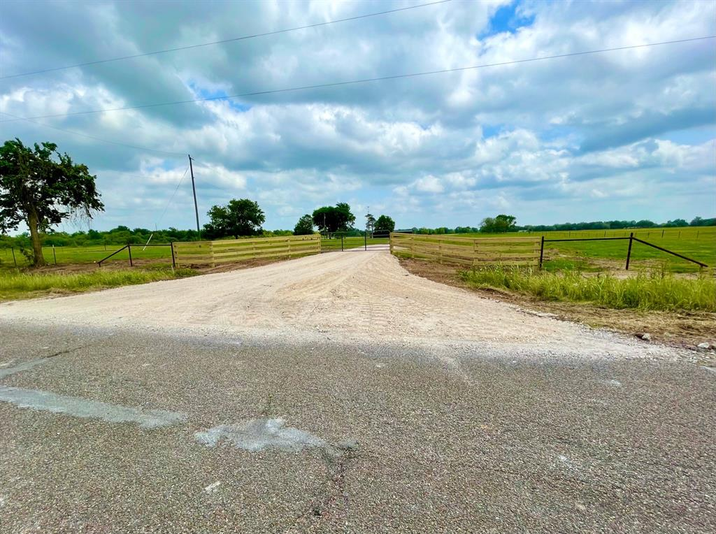 Beautiful country acreage! Hard to find 10.365 +/- unrestricted acreage in the highly desired area of Bellville Texas. This property comes complete with newly constructed barbed fire-wire perimeter fencing, quality built 4 rail entryway with a culverted entry drive through the property gate. (this tracts entry drive scheduled for completion May 14th, entry drive photos of a neighboring tract with same build specifications) Currently Ag exempt with zero flood plain, the land is primarily open with scattered trees and improved and native grasses. Electric and water are available along the approximate 340 feet of paved county road frontage on school road with easy and quick access to the HWY 159 corridor which will quickly get you anywhere you want to be for business, living or leisure.