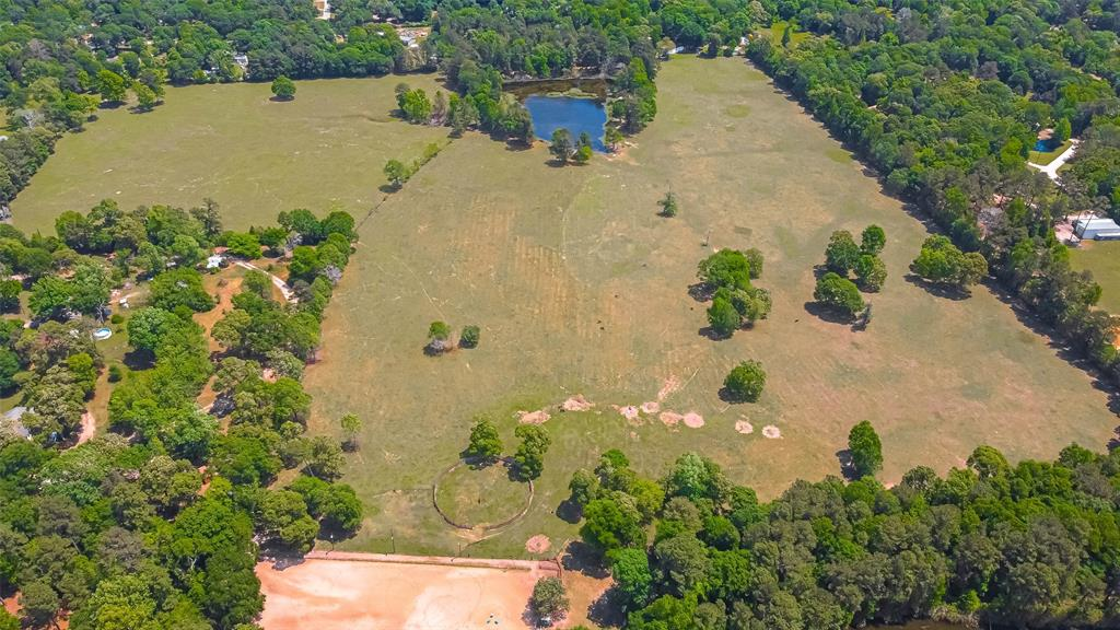 PERFECT HOME FOR HORSE LOVERS. BEAUTIFUL UNRESTRICTED 49.154 ACRES LOCATED ON FM 1484 ONE MILE OFF HWY 105. PROPERTY NOT IN FLOOD PLAIN. APPROXIMATELY 1000+ FT. OF ROAD FRONTAGE. LOVELY 2 STORY RANCH HOUSE WITH PORCHES ON 3 SIDES.  PROPERTY HAS A 2 AC. STOCK POND, ROPING ARENA WITH LIGHTS, HORSE BARN WITH TACK ROOM AND FEED ROOM, STORAGE SHED FOR EQUIPMENT, ROUND PEN, PROPERTY FENCED & CROSS FENCED.  ALSO PROPERTY IS SUITABLE FOR MULTI-FAMILY USE.  CITY WATER, AND EASY ACCESS TO ELECTRICITY AND NATURAL GAS.