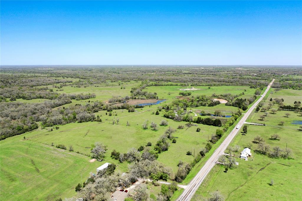 What would you do with 196 Acres in Madison County, Texas? Cattle, Recreational, Hunting you decide!! Quiet and secluded with breathtaking views and multiple homesite possibilities. There is a mobile home in place that will allow you time to decide where to build if you so choose or a place to stay during hunting season. This ranch offers 150 acres of improved pastures for both horses and cattle while also providing plenty of potential for hunting and relaxing. Caney Creek provides generous cover and water for an abundance of wildlife. From full-time ranch living or family weekend/seasonal hunting, recreational ranch, or cattle-hay production, this tract of land awaits your choice. Give The Wells Team a call today!!  INVESTORS- this one is worth a good look and could be easily subdivided! 5100ft of HWY 90 and only 3 miles to town.