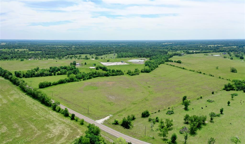 Gorgeous and ready for your DREAM HOME or weekend cabin!! Enjoy 1075ft of frontage making access quick and easy and just right for a  private entrance. Open pastures offer several possibilities for livestock while dotted, mature hardwoods line the seasonal creek.  Call The Wells Team today for your personal tour!!
