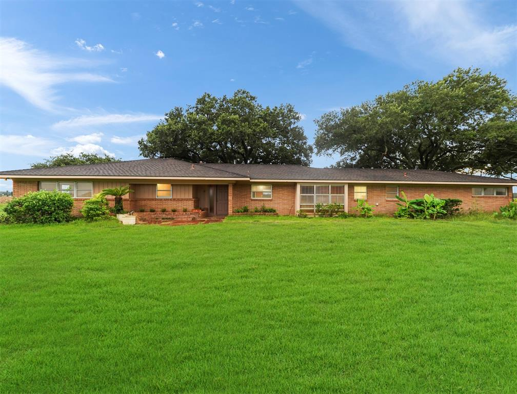This beautiful home sits on 8 acres, it's a 3 bedroom with 2 full bathrooms, Game room with a bar for entertaining, big patio and an extra building to make a mancave, craft room, etc. Beautiful patio with a waterfall and bridge.  70 Minutes from Houston down HWY 59 South.  This home is surrounded by farmland, come see this charming country home and land.