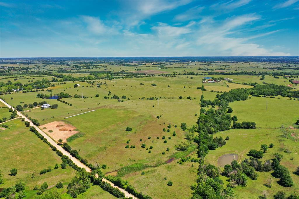 This unrestricted land is ready for you to call it home! 10.127 acres of open space allows you to build your home, no matter the size, and have plenty of room left to sprawl out and have a garden and or animals... from horses to cows, it is ready for you! This tract is part of a 20.5-acre tract that can be purchased all as one.
