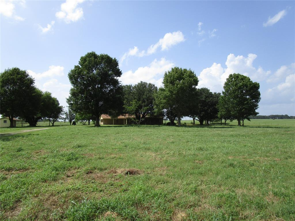 120.349 ACRES JUST EAST OF CROCKETT ON STATE HWY 7. ROLLING PASTURES, EXCELLENT GRAZING, 60 X 40 HAY BARN ON SLAB. 40 X 30 COVERED AREA FOR EQUIPMENT. PROPERTY IS FENCED AND CROSS FENCED, NICE STOCK POND, WORKING PENS. BACK OF TRACT HAS SMALL PORTION WOODED ACREAGE,  THIS IS THE IDEAL PLACE TO BUILD YOUR DREAM HOME AND EXPAND OR START YOU LIVESTOCK OPERATION.