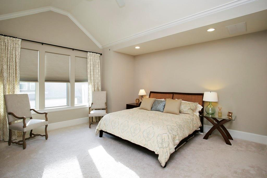 The primary bedroom suite is big, with an oversized walk in closet, vaulted ceilings, and recessed lighting.