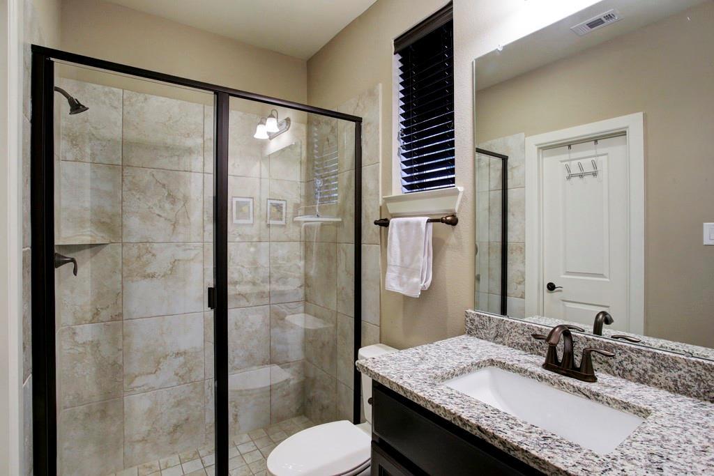 First floor bathroom. Glass walk-in shower, walk-in closet & granite counters & sink all ensuite.