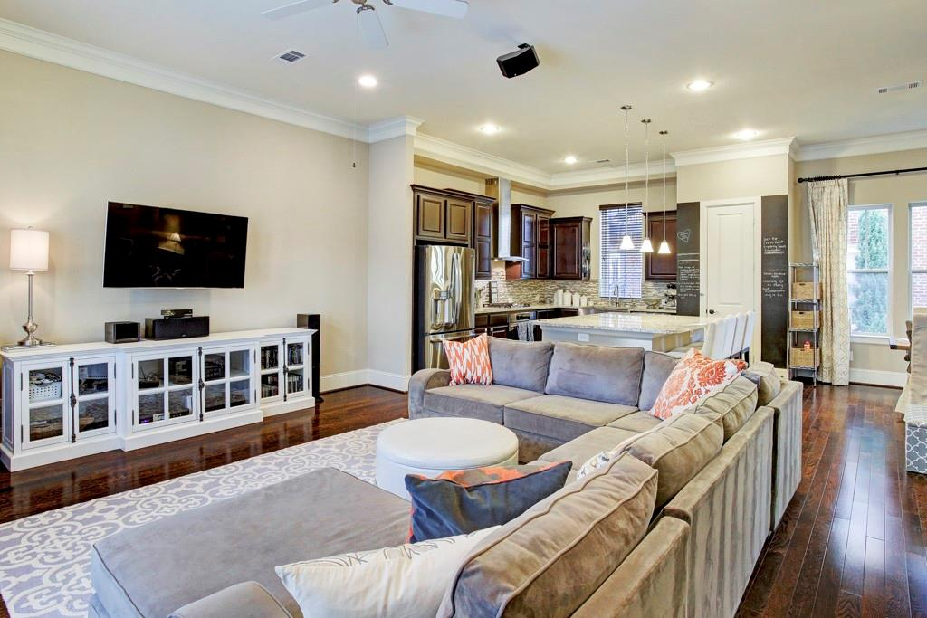 The entire second floor...living room flowing seamlessly into the kitchen & dining areas exhibits thoughtfully designed spaces.