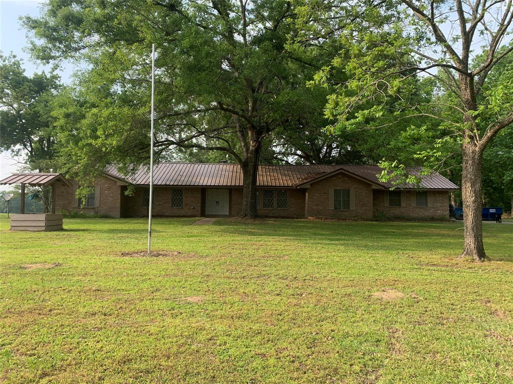 This spacious 4/3 home sits on 10-beautiful acres. An asphalt driveway leads you to the house. There is new flooring throughout, quality carpet in the bedrooms and sturdy wood-look vinyl in the common areas. The living room is open to the dining area and adjacent to the kitchen, and features a large, curved brick fireplace. There is a nice sized sunroom off the living room as well. There are bedrooms (one with built-in deck/office space) on either side of the hallway heading away from the living room. The large master bedroom and attached bathroom are at the end of the hall. Attached garage, utility room, and another bonus room/office are on the opposite end of the house from the master. Outside, there are multiple outbuildings, and the property is fenced, and cross-fenced. There is a metal shop on a slab with two roll-up doors, two metal barns, and a set of working pens with squeeze chute. There is great hunting potential here as well.