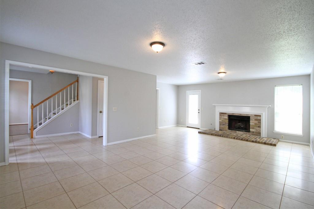 Spacious living room features fresh interior paint and lots of natural light.