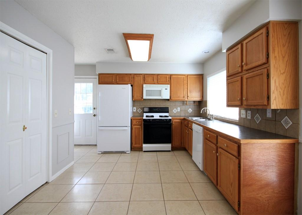 The kitchen has lots of cabinet space and two pantries for additional storage.