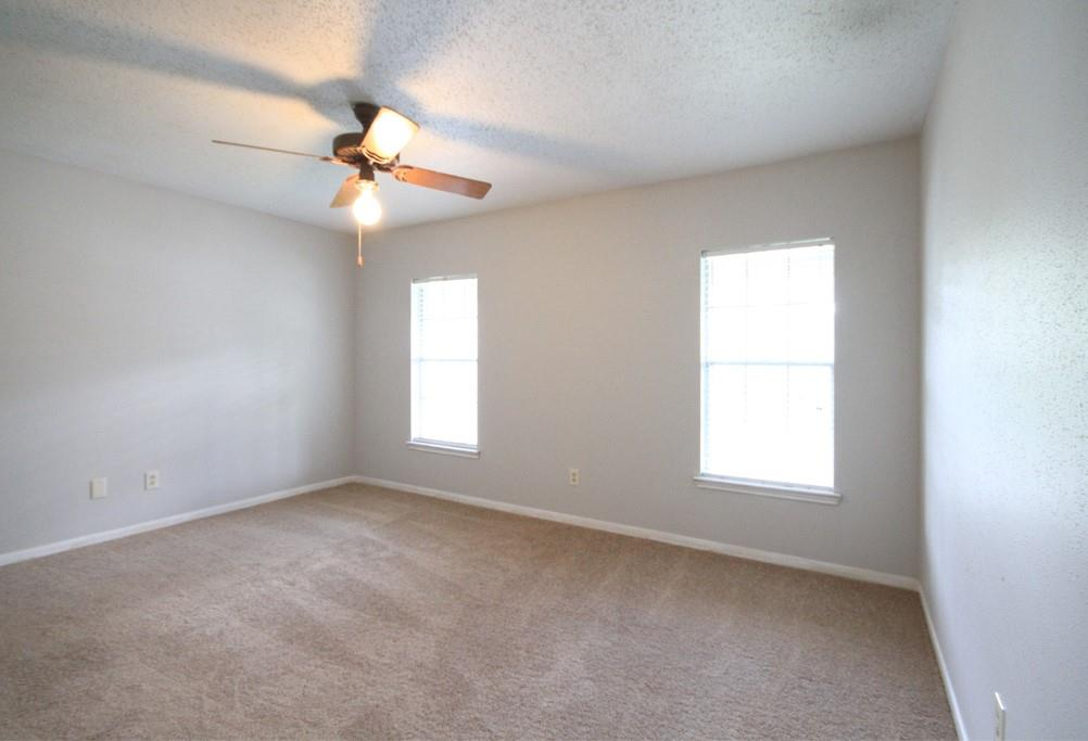 The primary suite features a large walk-in closet.