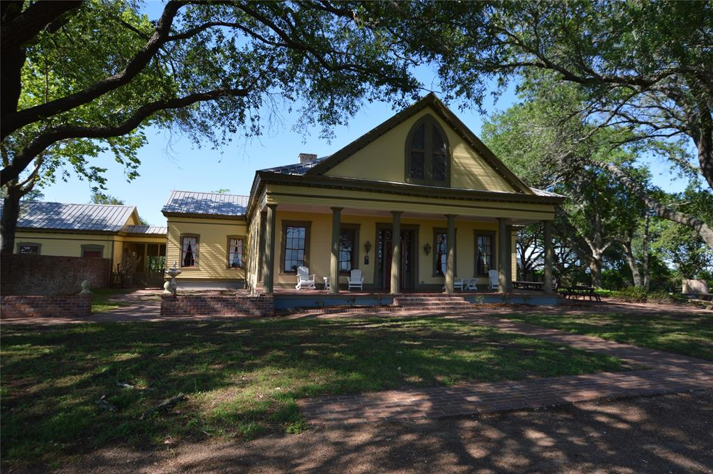 This lovely home offers the opportunity to own a unique piece of Texas history.  The beautiful and spacious plantation home was built by Dr. John W. Lockhart in 1850 and was originally part of a 1,000 acre cotton and corn plantation.  The historic home features high ceilings and wood floors of native cedar, pine, ash, and black walnut.    The home includes the original living and dining rooms, a modern kitchen, and a large master suite with a spacious master bath with two separate sinks and a large walk-in closet.  A bedroom off of the front hall was a guest bedroom that was reported to have been used by Sam Houston on visits to the area.  Included in the property is a charming guesthouse.  In addition to making a unique and wonderful private home, this property would be ideal for a bed and breakfast, an Airbnb, or an antique shop.  Located within one mile of historic Chappell Hill with shops, restaurants, and historic sites, approximately one hour driving time from Houston.