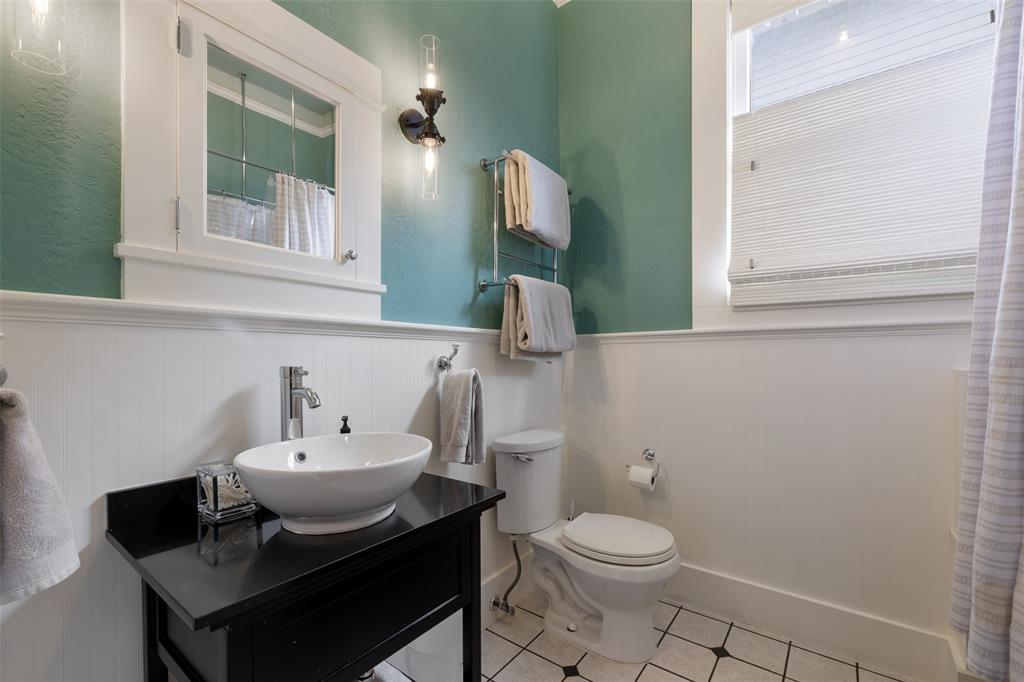 Downstairs bathroom has been remodeled and beautified with bathtub and shower.
