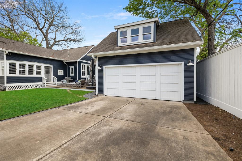 Driveway to double garage with auto gate.
