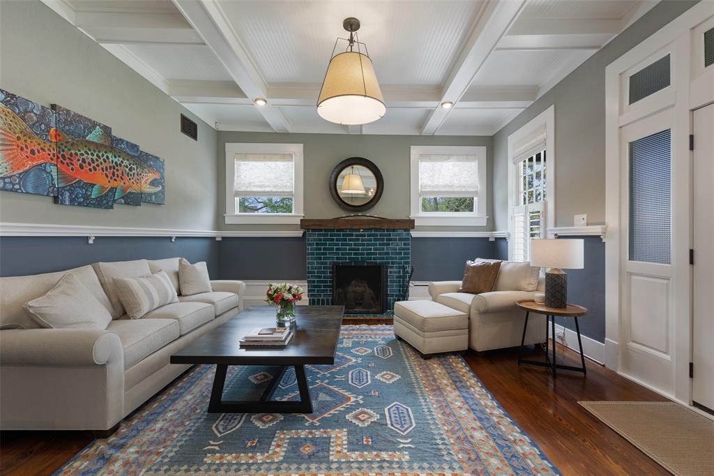 Entrance room is a dream with original paneled ceilings and fire place.