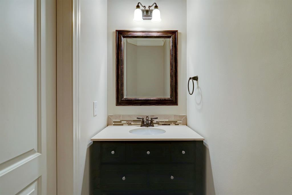 The half bath on the first level sits discreetly across from the full kitchen wall, between the dining and family rooms.