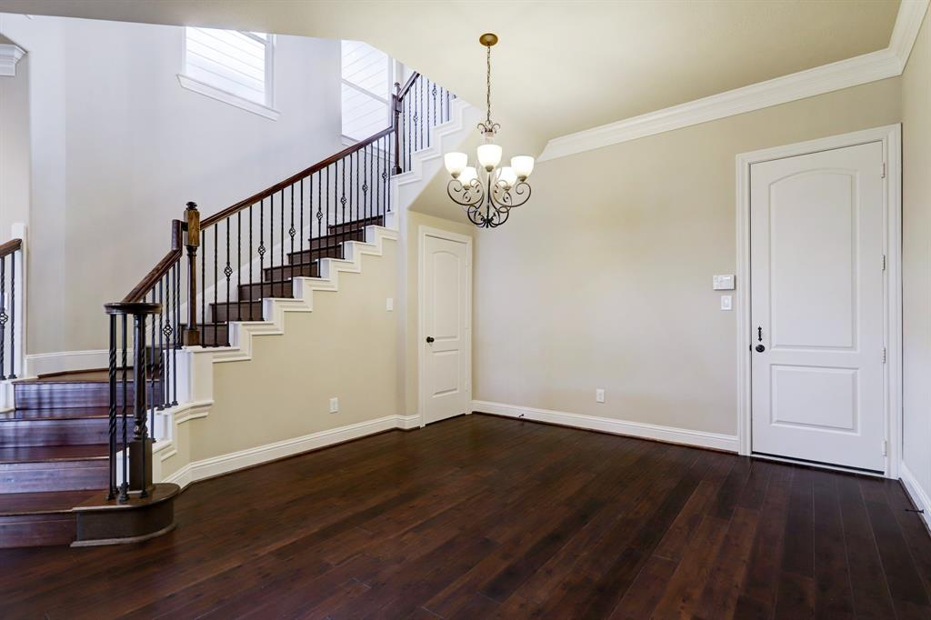 This dining room will comfortably accommodate a six to eight person table and chairs. The windows on the staircase wall ensure this room is also graced with natural light.