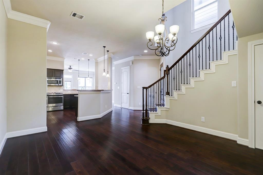 This last perspective of the first floor from dining room to kitchen to family room, exhibits how wonderfully open and bright is this floor plan.