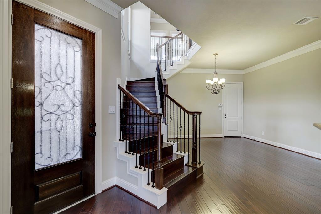 Just inside the front door, the gracious winding staircase leads to the second floor including the bedrooms, full baths and office space.