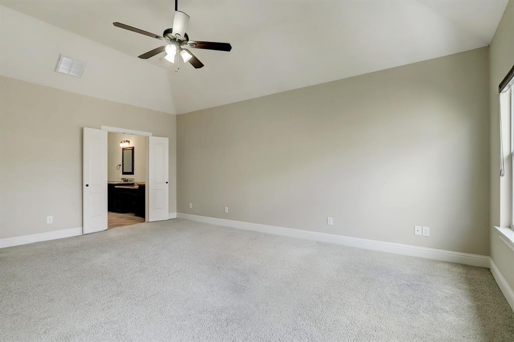 There are multiple options for furniture placement in this room, it's so generously sized. French doors lead to the primary bath.