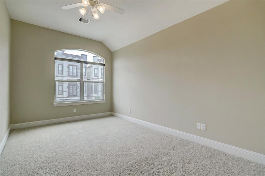 The first of two bedrooms, each with its own walk-in closet. Both secondary bedrooms overlook Kiam St.