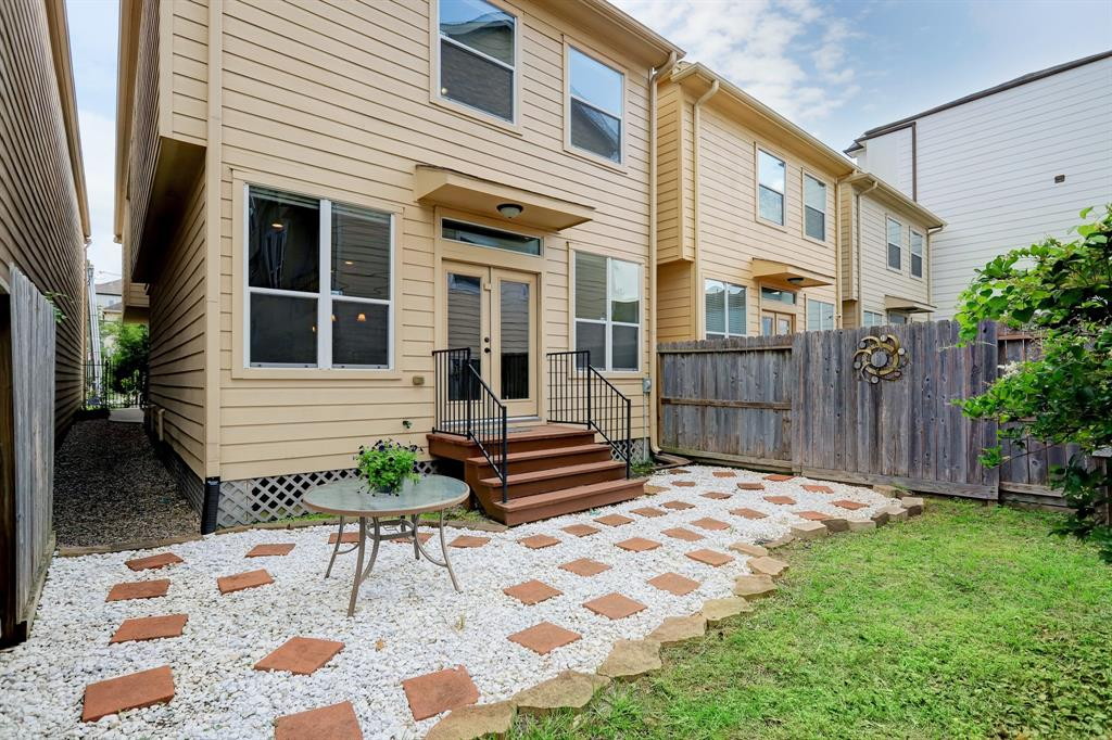 Look at this fabulous back yard, so unusual in central Houston! Bring your kids, pups and friends and entertain outside year round.