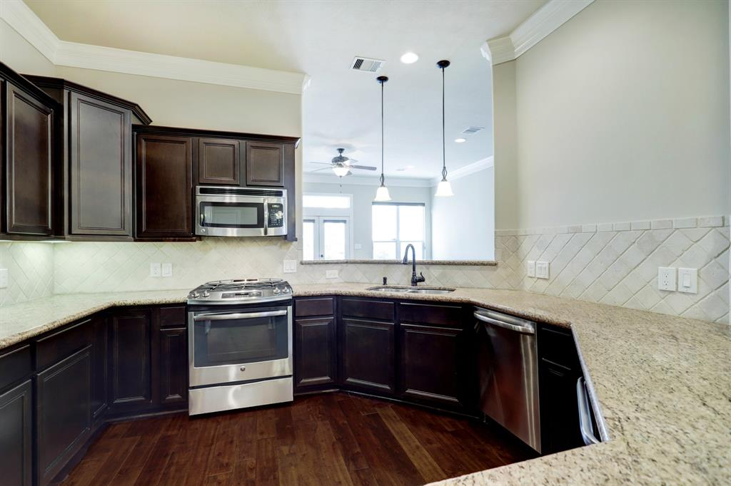 There is so much granite counter space here. Another bonus is under cabinet lighting.