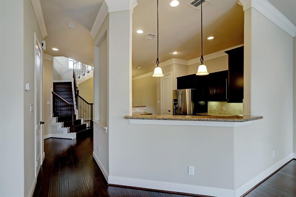 This breakfast bar with a small overhang on the family room side is just perfect for a few bar height stools!