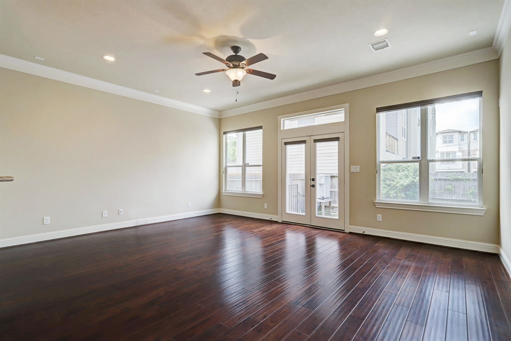This family room is quite spacious, with two walls offering space for a TV in or out of a cabinet. The French doors lead to the private, fenced back yard. There is wonderful light in this room facing north.