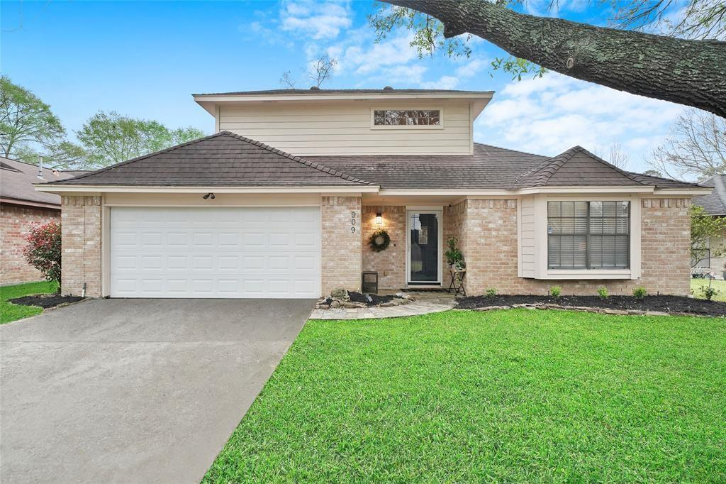 Three bedroom, two and one-half bath gorgeously updated home conveniently located close to Loop 336, I-45, Grand Central Park, dining, medical facilities, shopping, and more!  This stunning home boasts sky-high ceilings, a beautiful open floor plan featuring a large family room, formal dining space, a convenient half bath. Primary suite downstairs.  Two gorgeous secondary rooms with a Hollywood bath upstairs. The kitchen is a stunner featuring two-toned light cabinetry, subway tile, high-end Granite counters, and stainless steel appliances, as well as updated lighting and fixtures. The home is situated on a large lot with a large covered back patio and has great outdoor space to relax on!