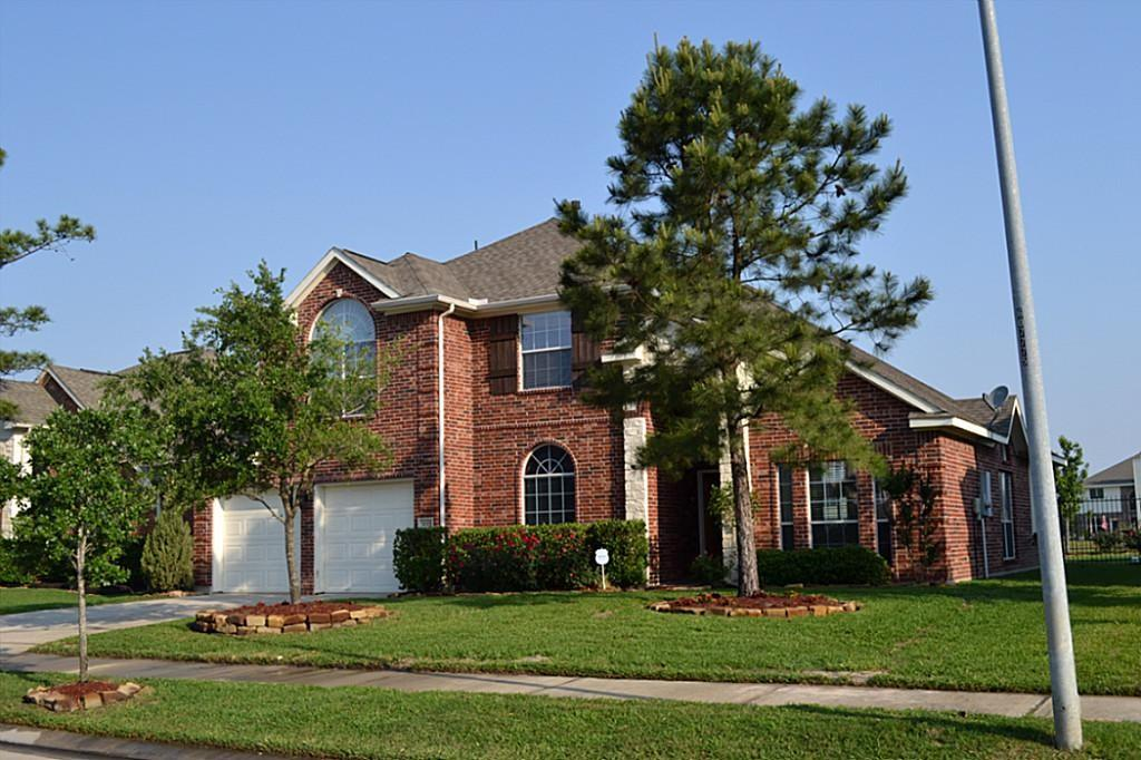 Style and charm are displayed with high ceilings, arches, and a flowing layout. Finishes include hardwood flooring throughout the 1st floor, stainless steel appliances, granite countertops, spacious primary bedroom with a large bay window on the first floor with a lovely lake view. There is a sprinkler system front and back, a gorgeous stamped concrete patio deck in the back with a pergola, and recently repaced wrought iron fencing with a gate to the walking path around the lake. This is much more than a house, it's truly a family lifestyle.