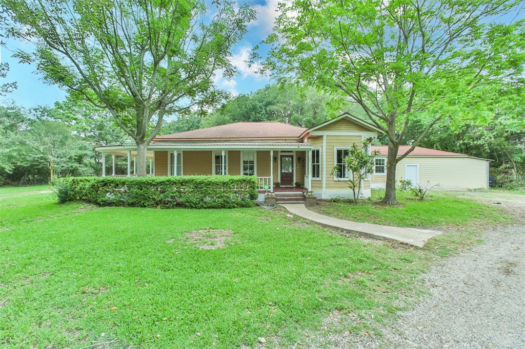 Charming one-story home on over five acres in unincorporated Tomball near Rosehill. A combination of original and updated features, including a wrap-around porch and wood stove. Main house has three bedrooms and two full bathrooms with a spacious family room open to the kitchen and a formal dining room. Kitchen has a gas range and is open to dining room. Garage apartment has two bedrooms, one full bath, full kitchen, and a flex space.  Spacious, wooded backyard. Easy access to 2920, Cypress Rosehill, and Grand Parkway. The location is convenient to schools, shopping centers, grocery stores, and restaurants. Zoned to Tomball ISD.