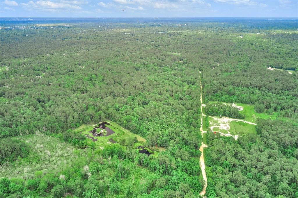 Retreat style living in Montgomery County. This wonderful  lot is ready for you to build your dream home on 33 Acres and offers many opportunities. 3 bedroom split level home with deck. Ponds already stocked with fish and plenty of space for hunting.