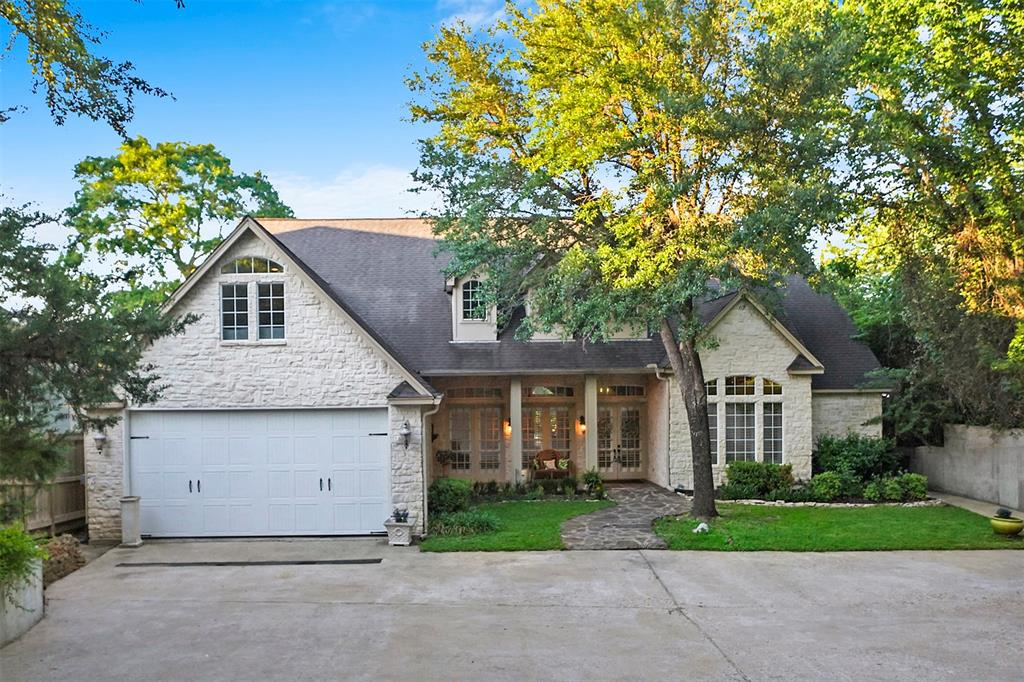 Welcome to this hidden waterfront gem in the gated community of Gemstone Estates on Lake Conroe. The wooded drive through the 1 acre property boasts a private and serene setting. The multi-level landscaped backyard features a pond made with landscape rock and stones has a tranquil waterfall. Large back porch, brick seating areas, fire pit area and steps leading to the lake complete this outdoor space! Inside, a large formal dining room welcomes you with large windows and slate flooring. The living room features high ceilings, built-ins and french doors overlooking the back porch and yard. Kitchen with granite counters, island and ample storage and counter space. The first floor game room is the perfect space to hang out and could also be use as a second living area. The large master bedroom with en-suite bath and separate office/study finish out the first floor. The second floor features two guest bedrooms as well as a flex room.