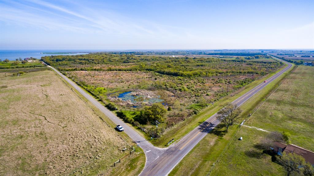 This  109.8134 acre  tract has been in the family since 1914. Property has about 13O0' Trinity Bay  frontage. Frontage on FM 562 and some frontage on Brandt Road.   Seller has August 2020  survey. Call us to email you a copy.  Call listing agent before you walk on property. Buyer to sign a hold harmless form.  This a great buy with plenty of bay front.