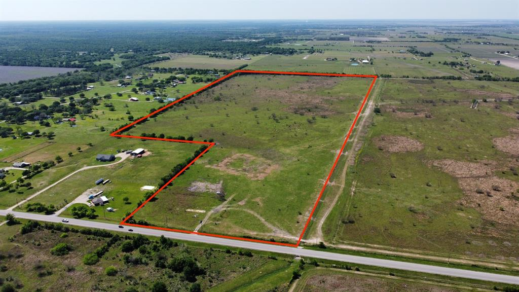 156+ Acre property located in Needville with frontage on FM 442 all zoned to Needville ISD.  This property has approximately 1375+/- ft of frontage with access to major freeways.  Currently in Agricultural exemption status and could remain as Ag land or purchase for an investment for future development for homes. There is mostly residential acreage properties with large land tracts surrounding it and additionally there is an acreage subdivision near this property that is currently in development.