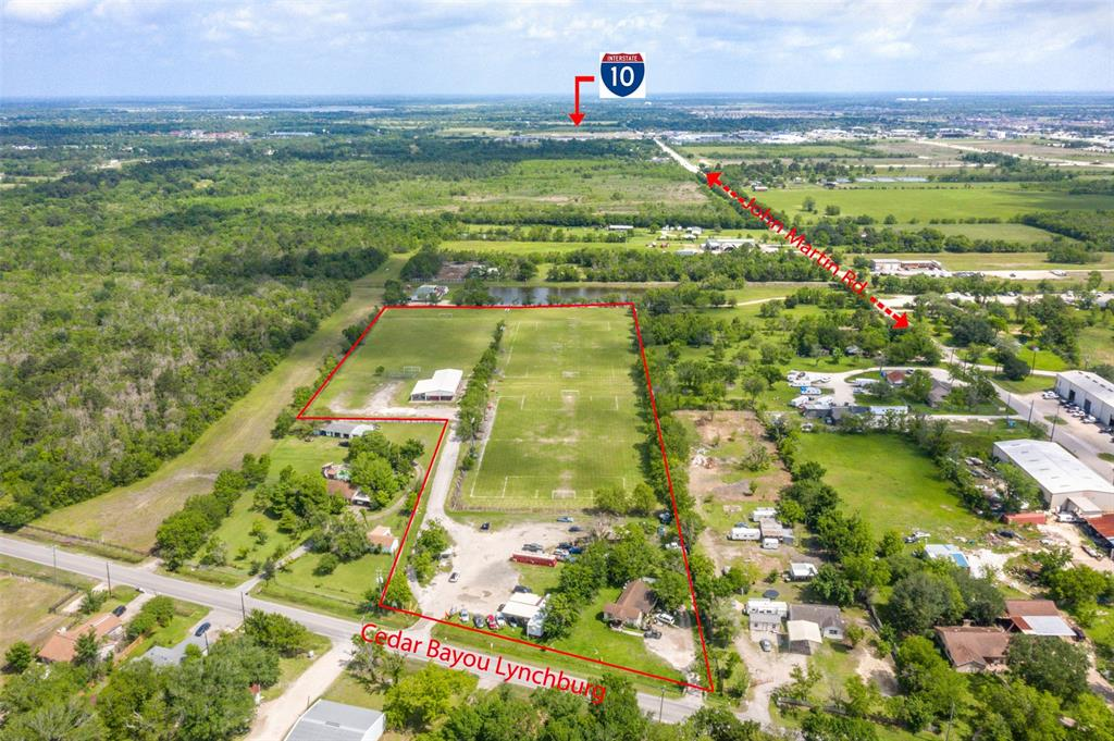 +/-7.1 Mixed zone acres. 251' foot of road frontage.  City water.  Currently used as a soccer field, used car dealership and insurance office.  Huge industrial lights on the fields. Lots of new commercial development  in the area. Easy access to I-10.