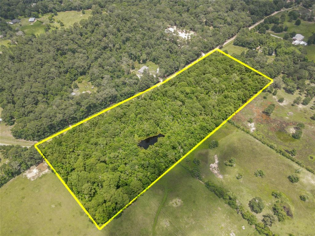Fantastic opportunity to purchase 8.6338 acres of beautiful wooded property with frontage on County Raod 3015. This tract would make a great investment property, agricultural land for farming, ranching or it would be an ideal country site for the custom home of your dreams! There is even a nice sized pond on the property. Located in the Tarkington Independent School District. Also as a bonus there is a very low tax rate of 1.539. Come out and see where your dreams can become reality!