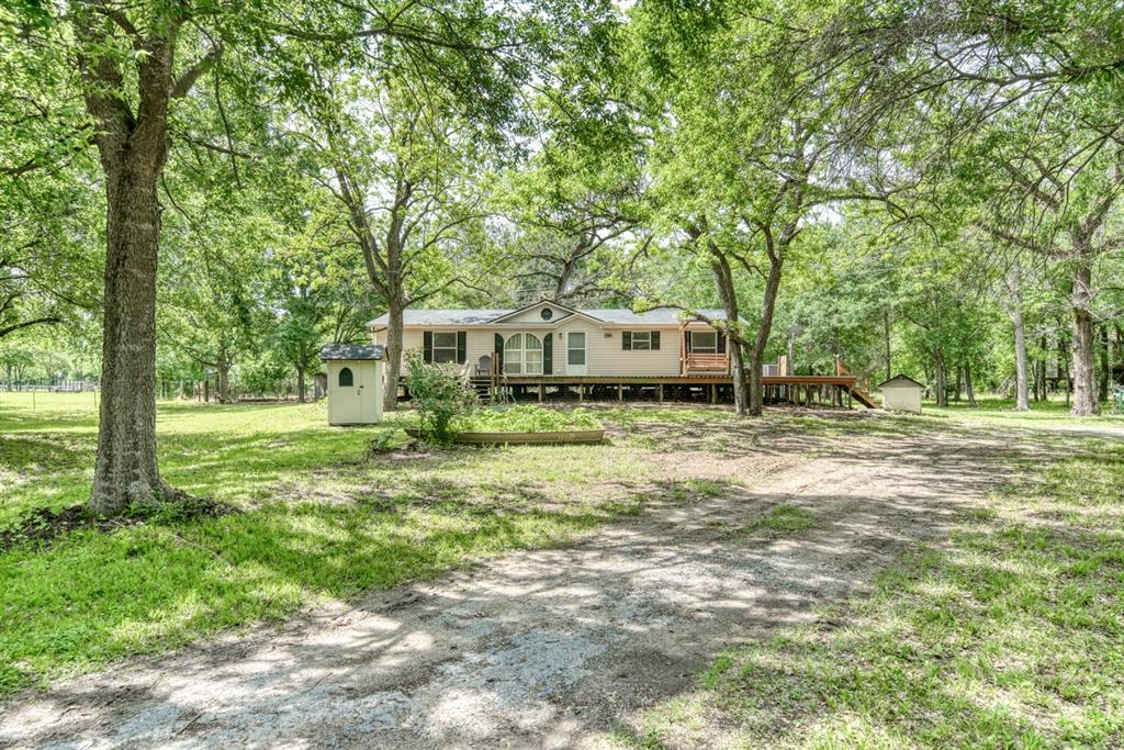 Secluded, Rural Country Property in Eastern Madison County. Updated 2001 Southern Star Lite Doublewide Mobile Home on 4.129 Acres in Midway that is move in ready. The home is 1400 SF featuring 3 bedrooms, 2 full baths, split plan, laminate floors throughout, fresh interior paint, NEW APPLIANCES COMING, and spacious outdoor decking. Outbuildings boasts a 10 x 16 with electricity and a workbench which can be used as a car carport, 8 x 12 storage shed, and 4 x 5 Garden Shed, partial fencing, and several mature trees that provide lots of shade. The property offers a pond and room for additional living quarters, your favorite animals, and/or a large garden. For the buyer who wants unrestricted living on a few acres of land, this property affords the opportunity to make this your full time residence or your favorite retreat. Also available for purchase on 1.179 acres also if buyer wants a smaller tract.