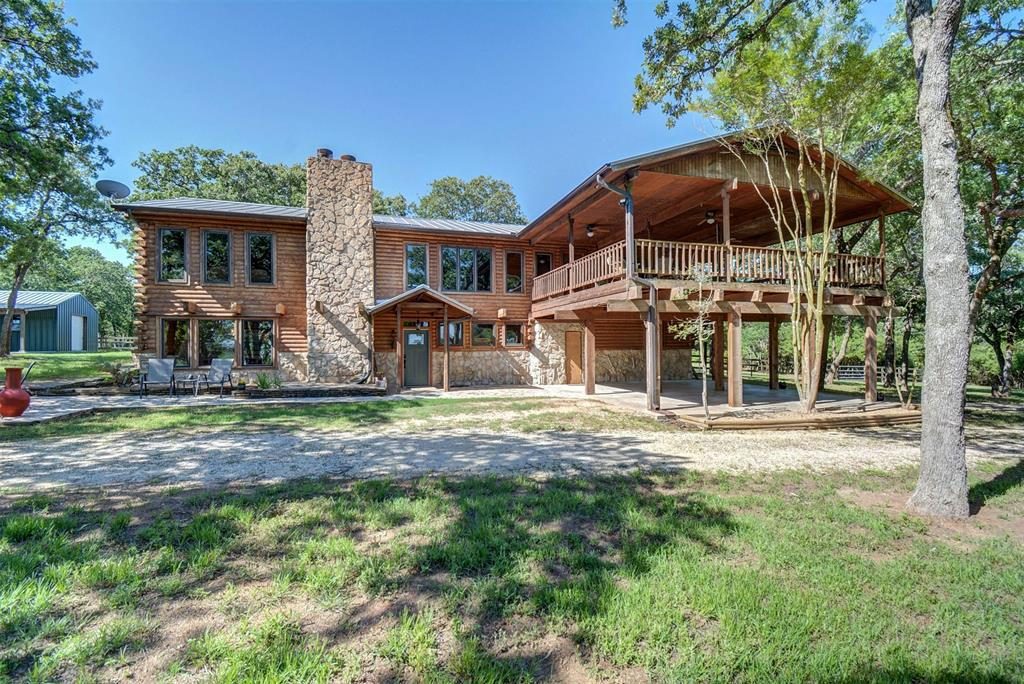 This gorgeous 3660 sq. ft custom log/stone home has been recently updated! Beautiful finish out and upgrades!  4 bedrooms, 2 full baths, 1 half bath, 3 living, dining area and breakfast bar. You have breathtaking views overlooking the pristine Rosanky Cattle Ranch pastures! This home is nestled in large oaks with gorgeous pastures for ultimate privacy! Slate floors throughout the home except the tiled bathrooms! Wood beams and tongue and groove wood ceilings and accent walls adds to the homes character! Beautifully updated kitchen with light granite counters, butcher block top island w/storage, a commercial style gas stove with double ovens, grill, 7 burners. The master and a 3rd guest room/office is upstairs along with a powder room! The second living room has beautiful beams and is very large with a wood burning free standing stove. un. Pole barn in the back pasture. There is an outbuilding that could be a great shop, tack room, etc. Only 30 mins to ABIA!