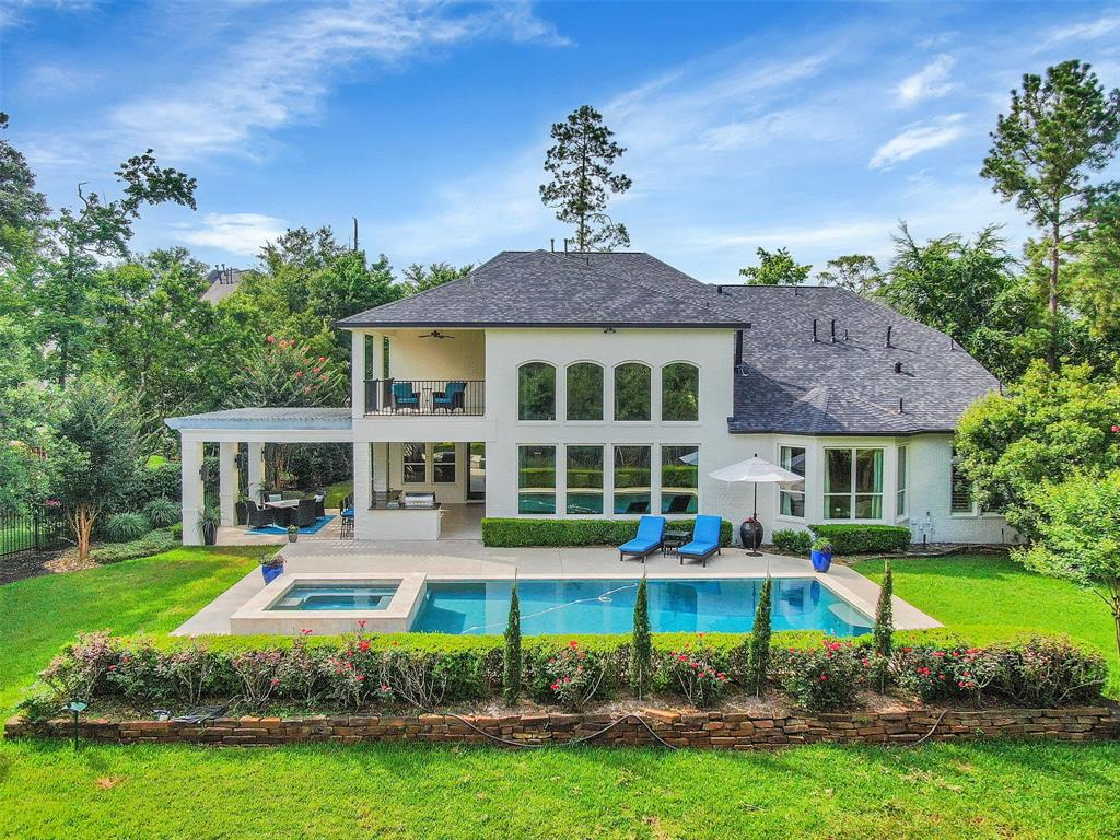 Exceptional opportunity to own a fully customized home on almost a 1/2 Acre lot on two holes of the Gary Player Course in Sterling Ridge, The Woodlands! This unique siting provides you with stunning views of fairway #4 and #6 plus a private green reserve directly behind the home. This 5 Bedroom/5 Bath/2 half bath home provides 5866 sf of indoor living space; 2-story family room, formal dining, private study, 2nd bedroom down, updated kitchen professional grade appliances, quartz countertops, media room and gameroom and large outdoor living spaces - pool/spa, full outdoor kitchen/covered patio/2nd story covered patio and additional backyard space. NEW Exterior Painted Brick, NEW Roof, NEW Wood Flooring throughout, NEW Carpeting, NEW Lighting, NEW Landscaping, Freshly painted, meticulously cared for by original owners. Close to Terramont Park and miles of walking trails! Hurry, this won't last!