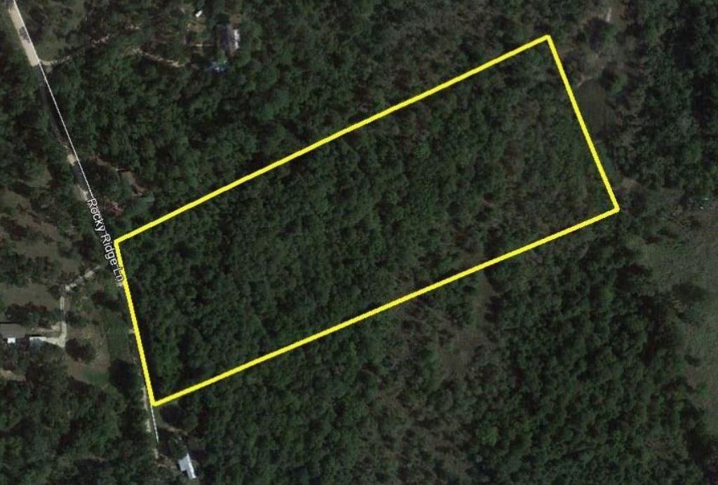 10 Acres: Secluded and unrestricted located on the South Side of Madison County with ease of access to I-45.  This land tract is approximately 95% wooded with mixed hard and softwoods, underbrush covering and level to slopping topography.  Ready for small scale development; build a site for home, hunting, or others.  Do not miss this opportunity to own a small piece of land in a quiet, private country setting.